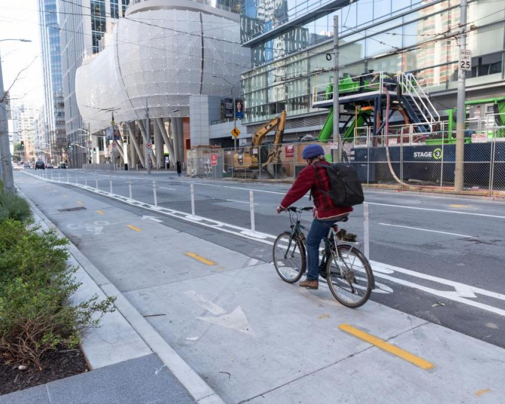 person biking in a two-way protected bikeway