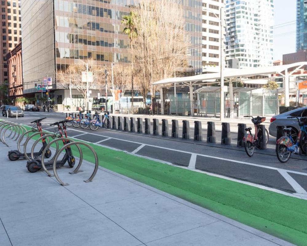 bike racks on the sidewalk, protected bikeway, and bikeshare station