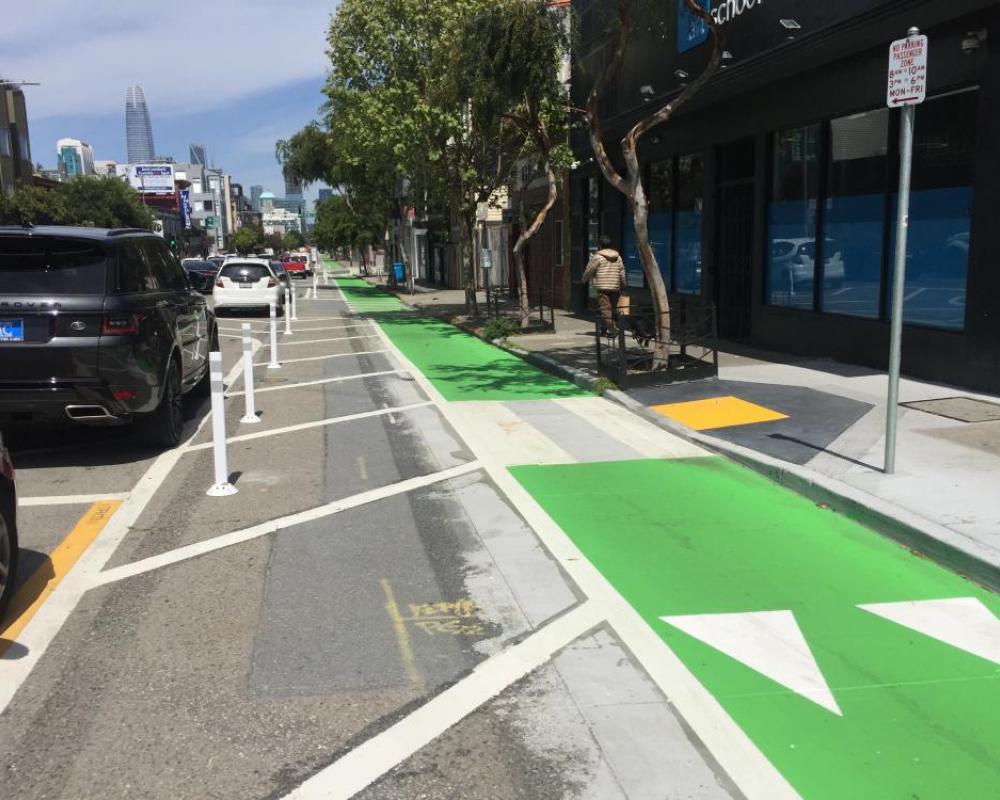 Protected bike lane on Folsom near 8th Street (2018 near-term improvements)