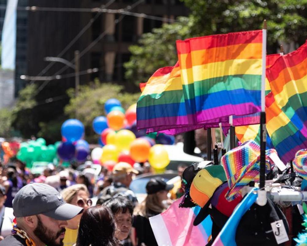 Photo of Pride Parade with SFMTA logo
