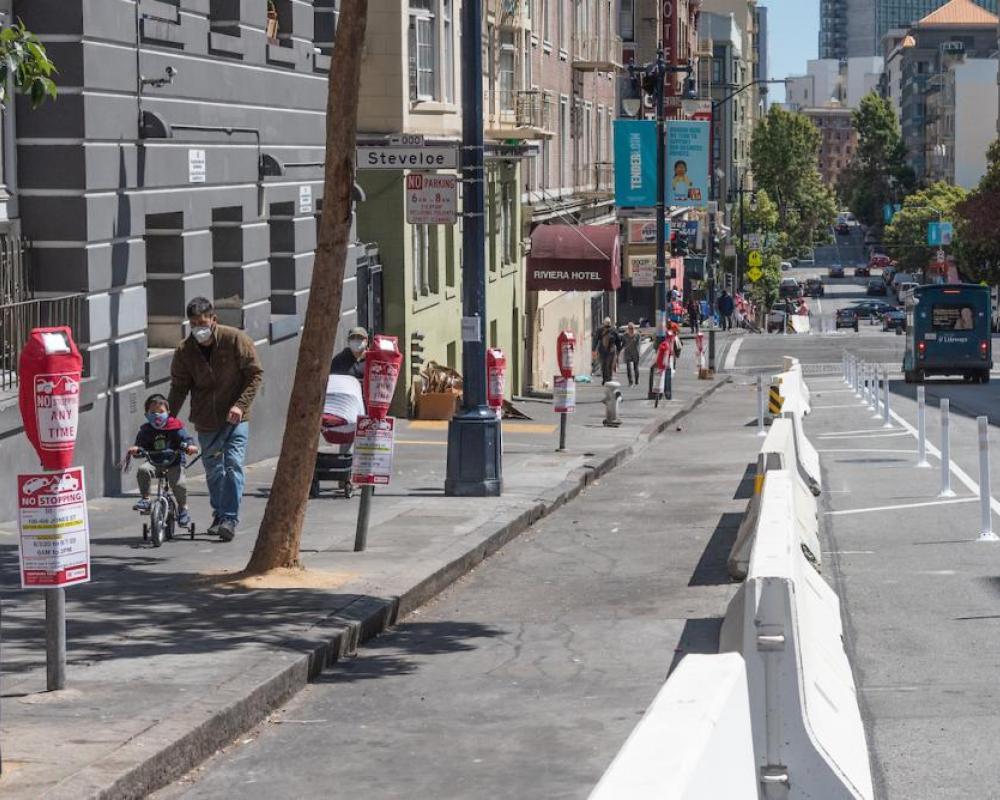 Pedestrians walking northbound on Jones Street