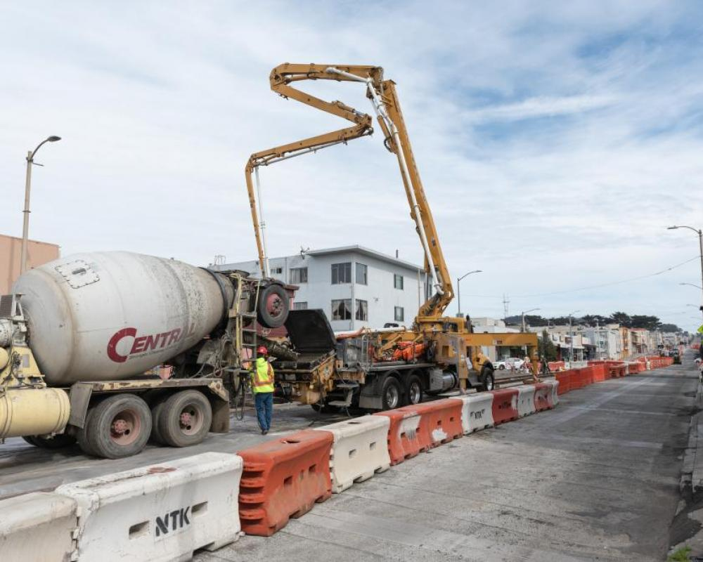 Photo of Crews pouring new concrete on Taraval Street