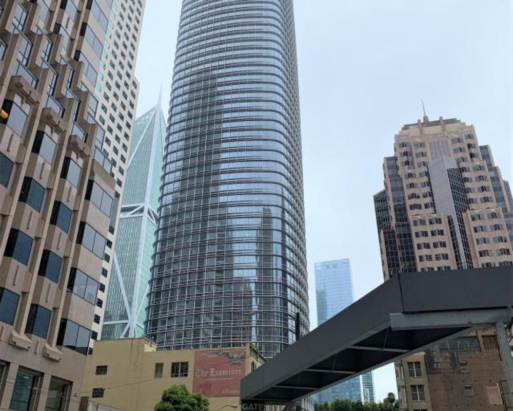 View of Salesforce Tower looking south from 1st Street, with construction at the Oceanwide Center at 50 1st Street