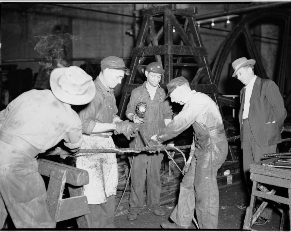 Four men splicing a cable