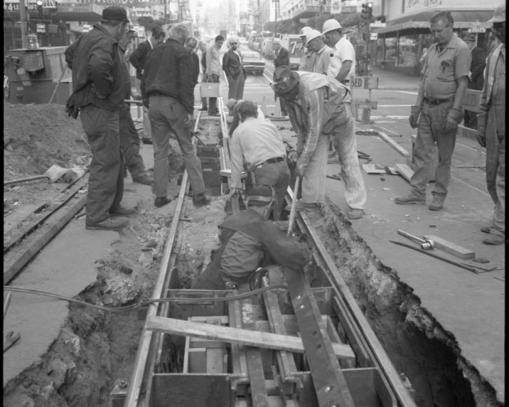 A track crew works to replace a depression beam and bumper bar