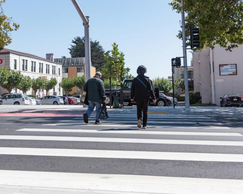 Photo of people walking across the new crosswalk