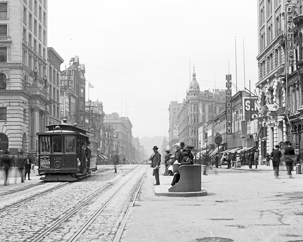 Looking west on Market Street from 3rd Street with a cable car on the left and a waiting station on the right in January 1906.
