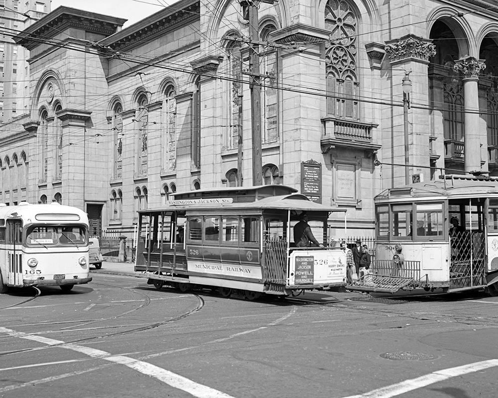 A unique sight: a Muni bus, a cable car, and streetcar, all posed together at the corner of Jackson Street and Fillmore in 1948.