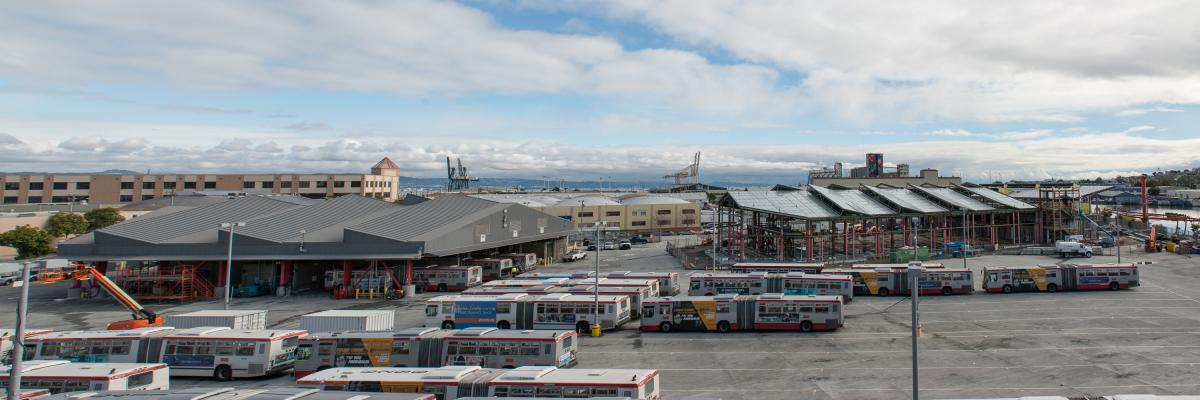 overhead panoramic view of Islais Creek Motor Coach facility bus yard and construction on new building