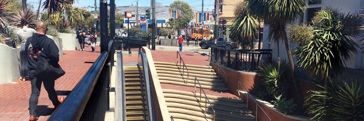 People walking around Harvey Milk Plaza and Castro Station entrance