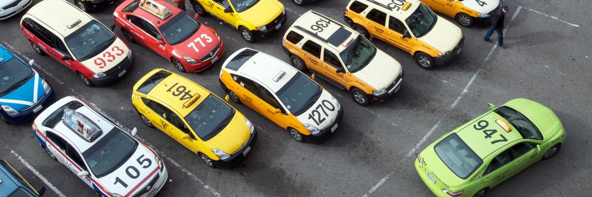 Taxi cabs parked waiting for passengers