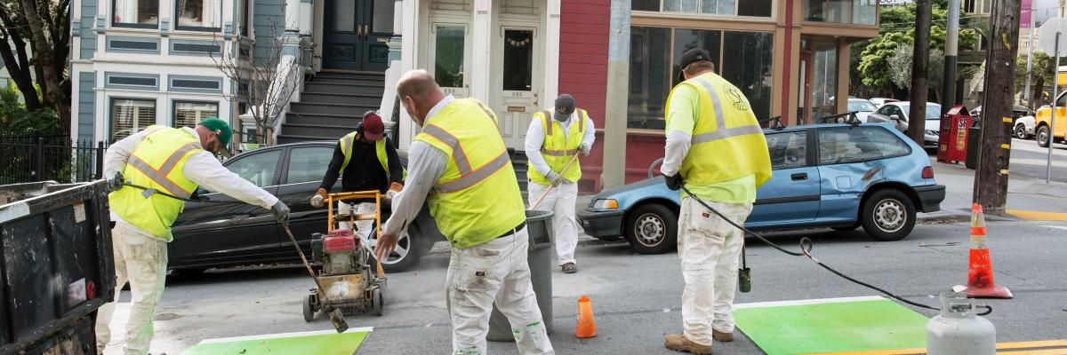 Paint Shop crew installing a new bike lane on Page Street in February 2016