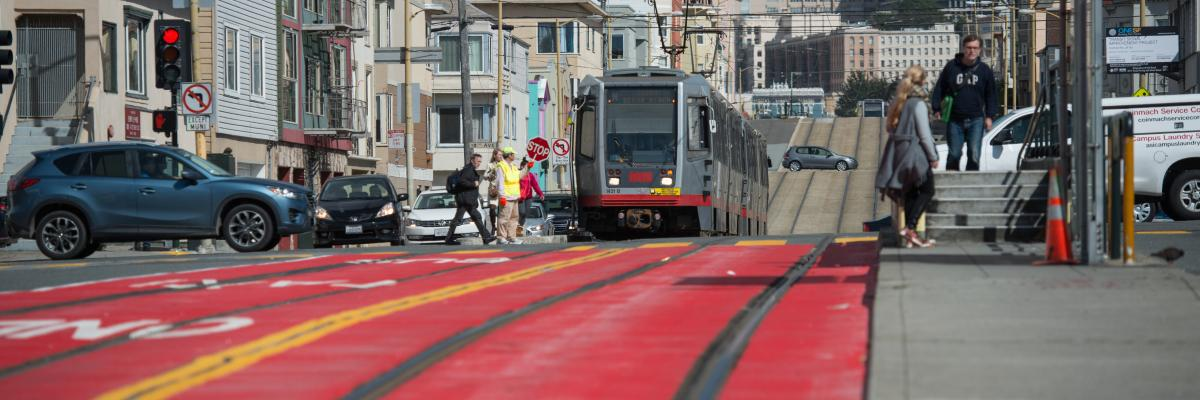 N Judah bus line with red transit lanes and visible boarding zone