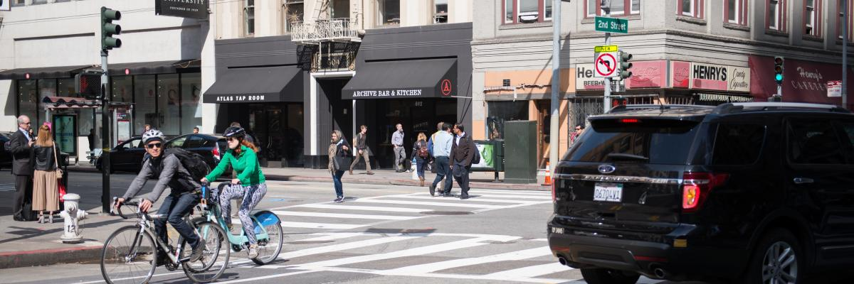 People biking on 2nd Street