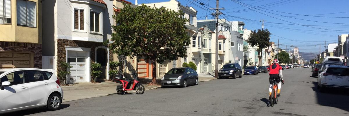 electric moped parked on 23rd Ave, San Francisco
