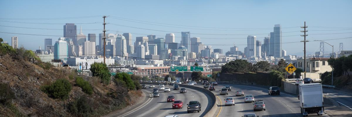 cars on freeway with skyline