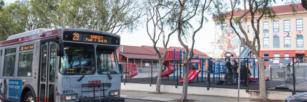 Muni bus passing by school