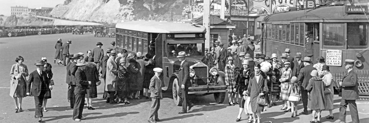 Muni B Geary streetcar and Muni bus with crowd in front of amusement park at Ocean Beach in 1927