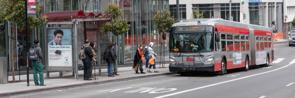 Passengers board the 38 Geary on Geary at Van Ness