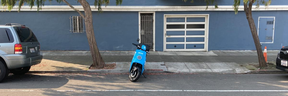 electric moped parked on Cabrillo Street, San Francisco