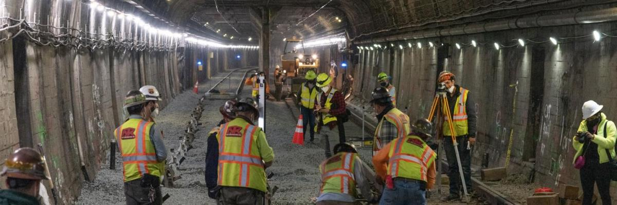 Workers laying new track in the Twin Peaks tunnel