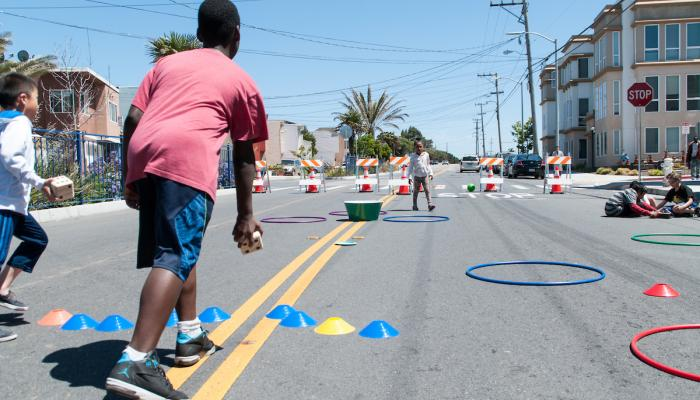 Children playing at a Play Streets block party