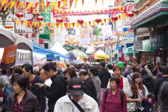 A crowded street at the Autumn Moon Festival in Chinatown.