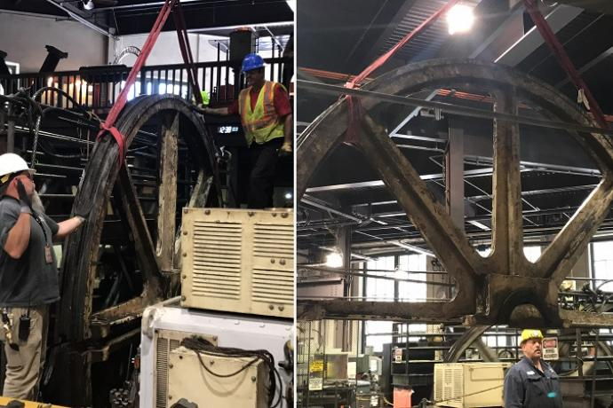 Photos of mechanics deconstructing a large, wheel-shaped sheave in the cable car barn and powerhouse.