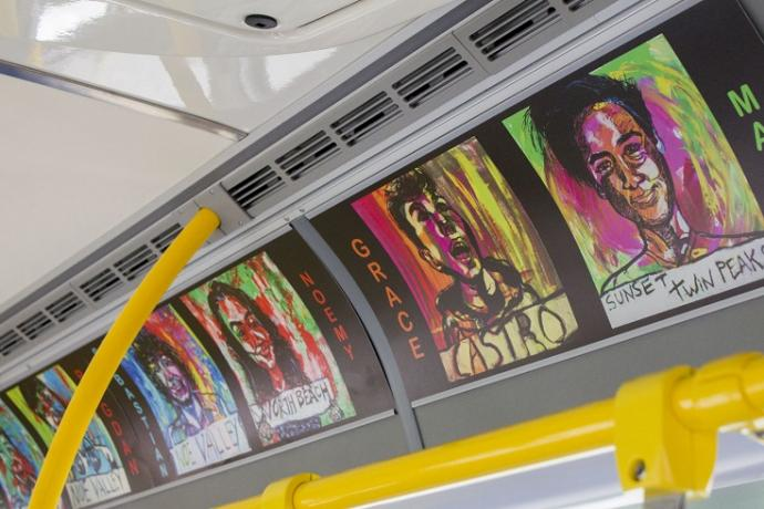 Artwork displayed in advertisement slots on a Muni bus.