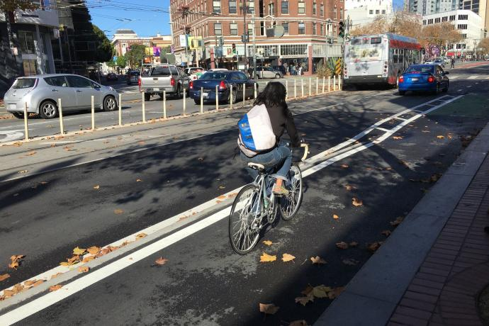 Cyclist using the newly installed raised bikeway