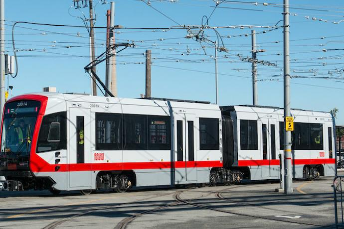 New Muni train in rail yard.