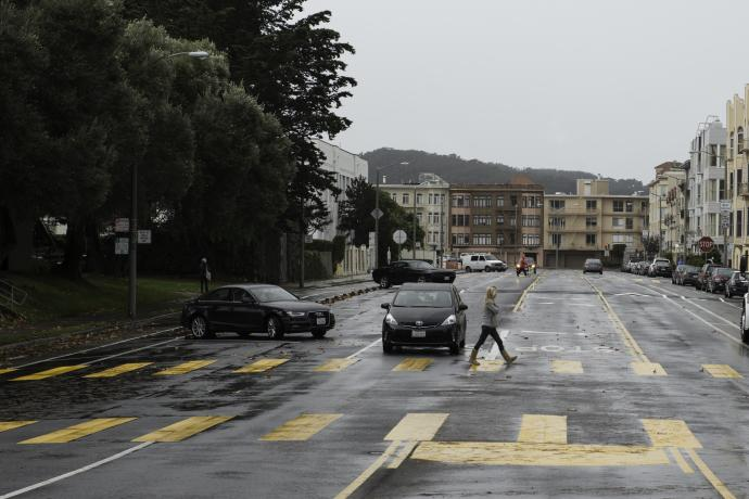 Woman crossing Bay Street in new high visibility school crosswalk