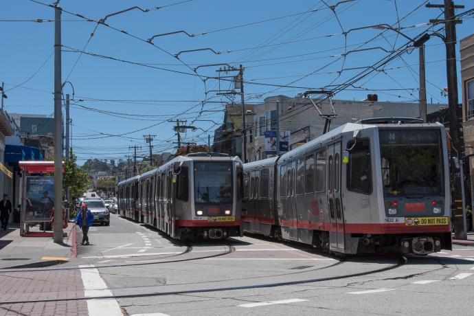 Two N Judah trains passing each other on 9th Avenue and Irving Street