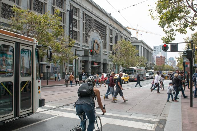 Pedestrians, cyclist, and Muni on Market Street near 5th