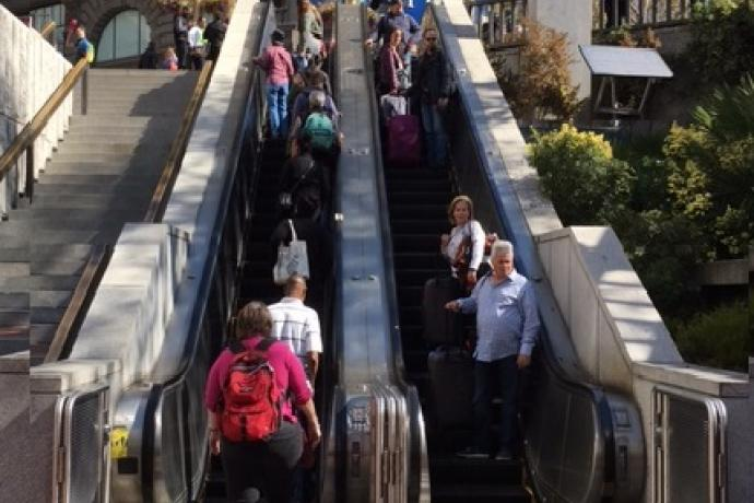Image of people coming down a muni metro escalator at Hallidie Plaza