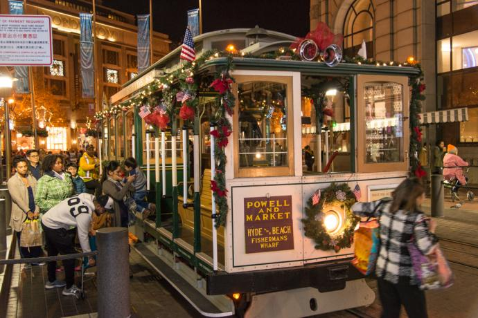 decorated cable car and passengers
