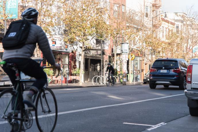 A cyclist and vehicle on Valencia Street