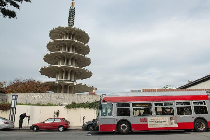 A 38 Geary coach stopping outside of Japantown.