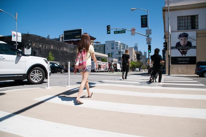 People using the crosswalk during the afternoon