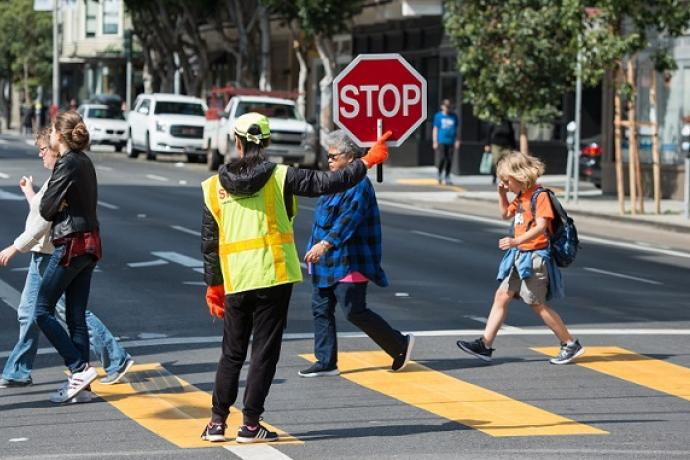 Kids crossing the street.