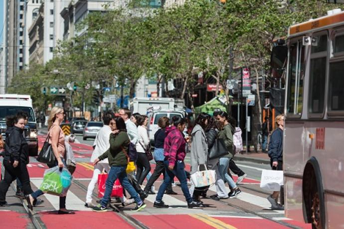 People crossing Market Street.