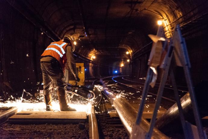 workers cutting rail