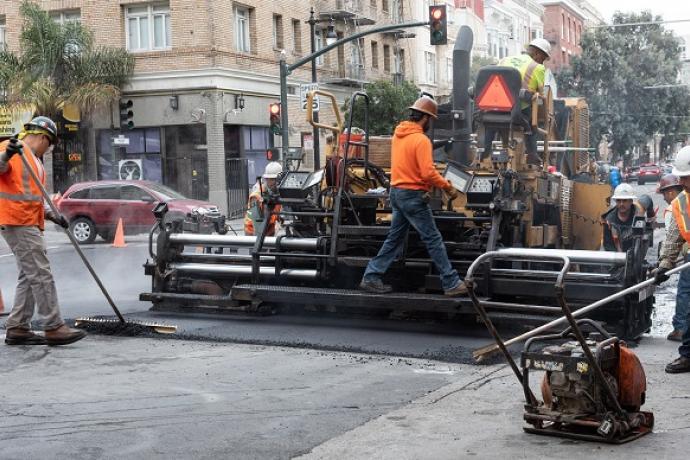 Men working on Polk Street.