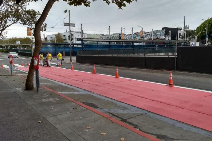 Red lanes being painted on Geary.