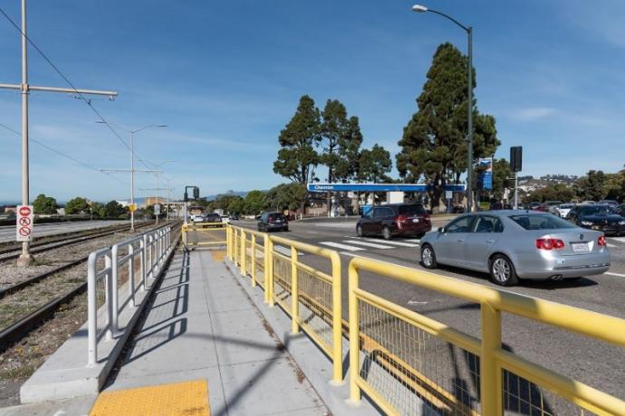 New pedestrian refuge for people walking across 19th Avenue.