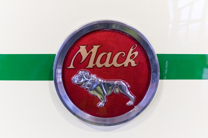 photo of Mack Truck Company logo on front of bus