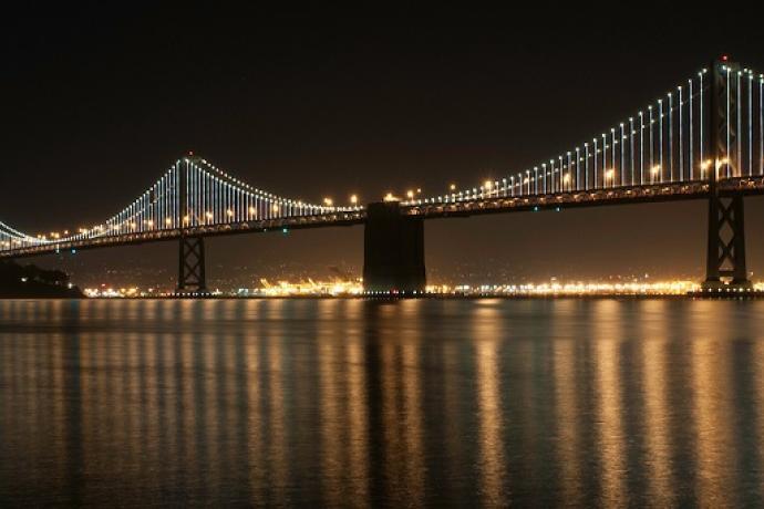 The Bay Bridge at night.