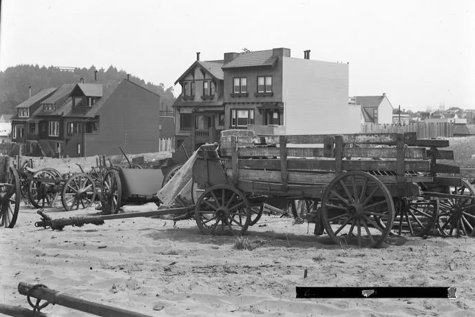 broken down wagons amidst sand