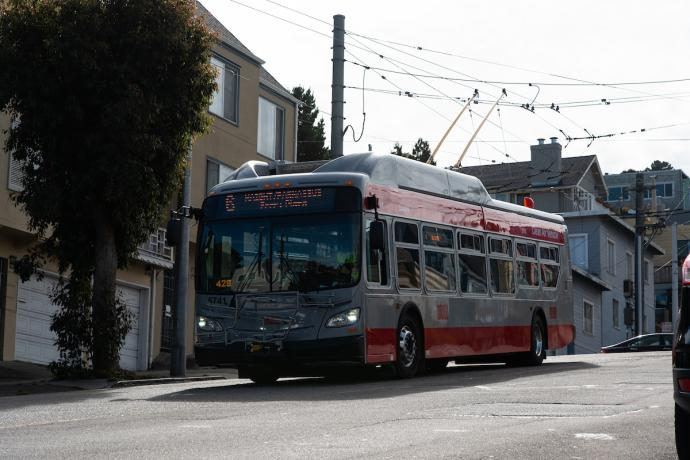 A 6 Parnassus red and silver Muni trolley bus