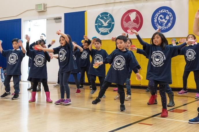 """First graders from Rosa Parks Elementary School dance to the Japanese song """"Paprika,"""" commemorating the 2020 Olympics in Tokyo."""